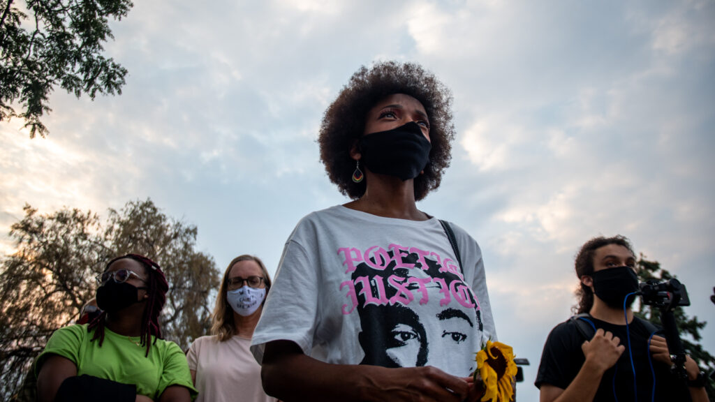 """Sheree Barbour listens to a speaker during the """"Protect Black Men: Colorado Action for Jacob Blake"""" gathering at Manual High School in Denver. Hundreds gathered in support of Jacob Blake, a Black man shot at least seven times in the back by police in Wisconsin."""