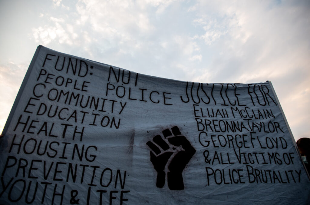 """A protest sign at the """"Protect Black Men: Colorado Action for Jacob Blake"""" gathering at Manual High School in Denver."""