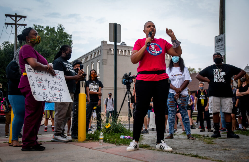 """Candace Bailey, an Aurora community organizer, speaks during the """"Protect Black Men: Colorado Action for Jacob Blake""""  about the legacy of white people enslaving, oppressing and killing Black people."""