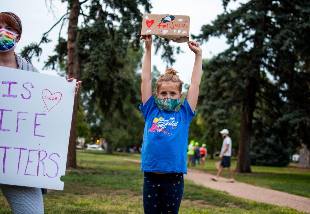Hazel Jones, 9, holds a homemade sign to support Jacob Blake.