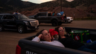 Nikkol Grimes, left, and Sonja Taylor relax while watching Grease during the 21st annual Film on the Rocks, drive-in edition at Red Rocks Park on Aug. 13, 2020. Grimes is a Grease fanatic who says she's probably seen the classic movie 50 times.