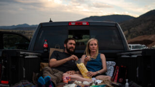 Austin Dyer and Hannah Broughton enjoy popcorn and the movie in their truck bed during the 21st annual Film on the Rocks, drive-in edition at Red Rocks Park on Aug. 13, 2020.