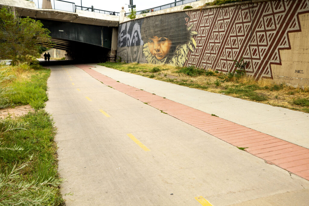 A mural by Alexandre Orion at Lincoln Street along the Cherry Creek Trail. Sept. 10, 2020.