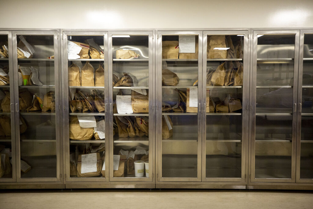 Storage lockers in Denver's Office of the Medical Examiner contain bags of ligatures used to complete suicide. Aug. 25, 2020.