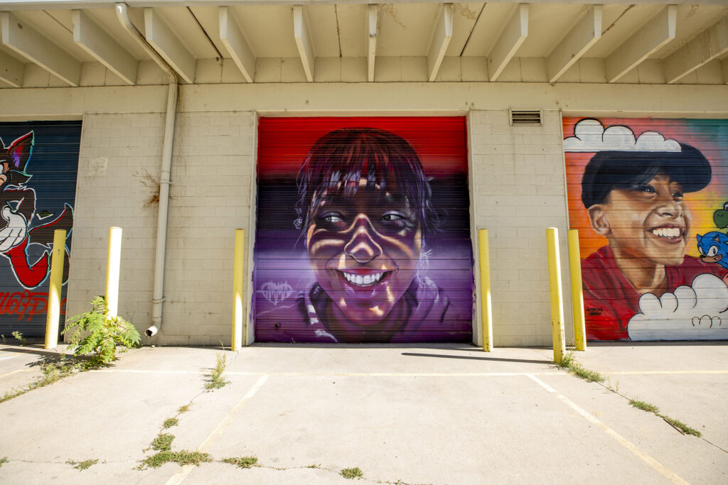 """A mural by """"Gamma"""" Acosta off Brighton Boulevard in Five Points. Sept. 3, 2020."""