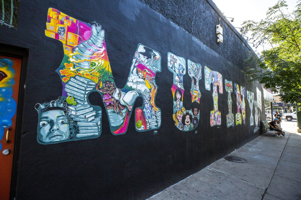 A mural by Patrick McGirr and Joshua Finley on the side of Mutiny Information Cafe on Broadway. Sept. 3, 2020.