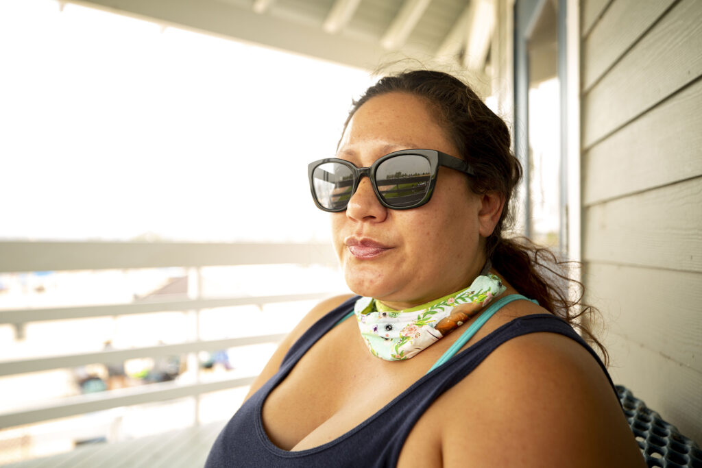 Lorraine Eloriaga sits near the beach at the Aurora Reservoir, where she comes often with her family. Lately, this quality time has felt a lot more important. Sept. 7, 2020.