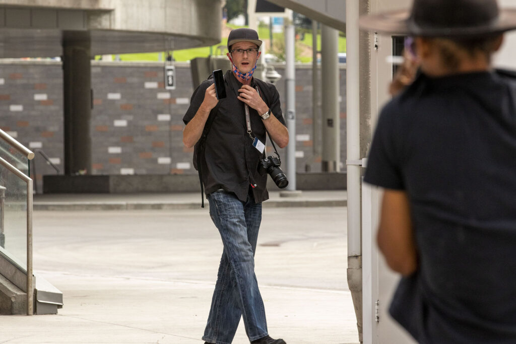 Joseph Camp shoots video of a protest on Sept. 19, 2020.