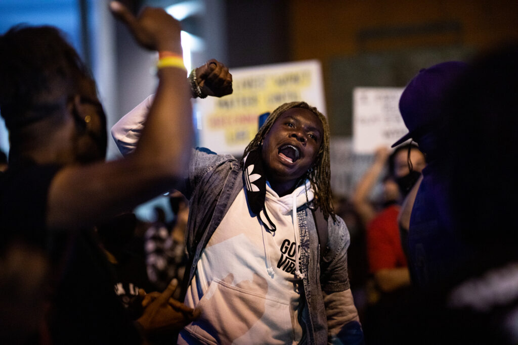 """A man yells, """"Breonna Taylor"""" on Sept. 23 in a Denver march during a rally for Breonna Taylor after a grand jury announced charges against one of the officers involved in her shooting death."""
