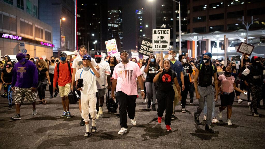 DPS school board member Tay Anderson leads hundreds of demonstrators through downtown Denver on Sept. 23 in Denver.