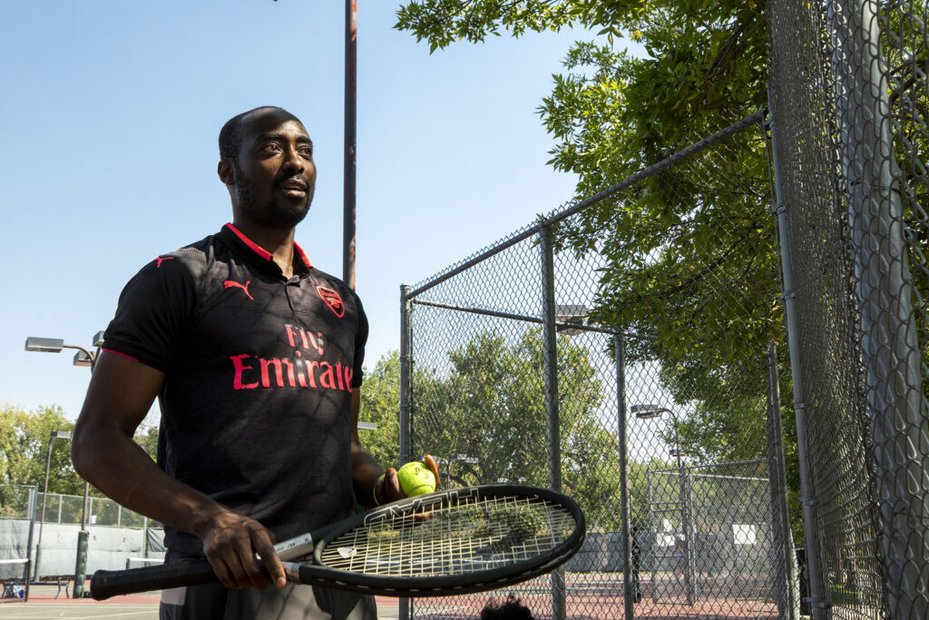 Ayande Ademola takes a break from a tennis game at City Park. Sept. 24, 2020.