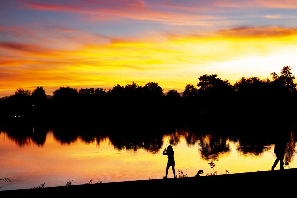 Anna (8) fishes under the tutelage of her father, Alexandros Vasilatos, around Grasmere Lake in Washington Park. Sept. 28, 2020.