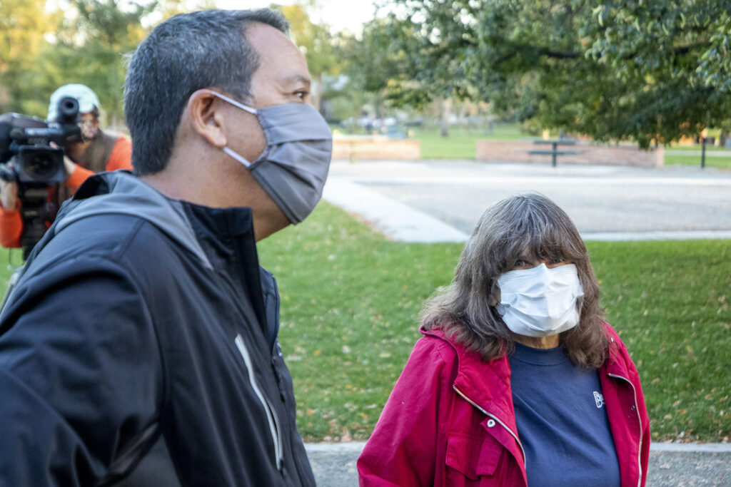 Animal rights activist Ellen Kessler and Scott Gilmore chat during a volunteer training at  Washington Park to scare geese with fake coyotes. Sept. 28, 2020.