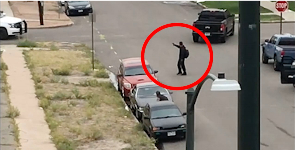 A still provided by Denver police showing Antonio Blackbear pointing an air soft gun at police officers inside an unmarked cruiser.