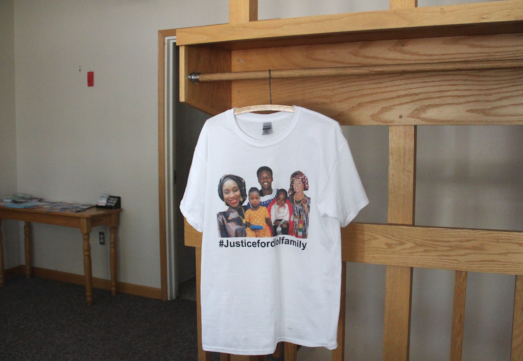 A shirt featuring the photos of the Diol family hangs near the entrance of the Rocky Mountain Welcome Center, where the African Leadership Group is located, on Wednesday, Sept. 30, 2020, in Aurora. (Esteban L. Hernandez/Denverite)