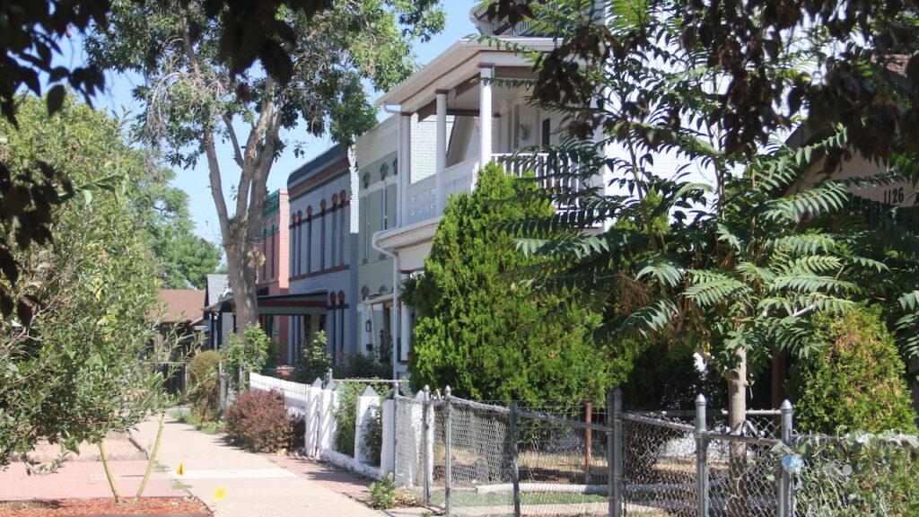 Houses along Mariposa Street on Sept. 1, 2020, in the Lincoln Park neighborhood in Denver. (Esteban L. Hernandez/Denverite)