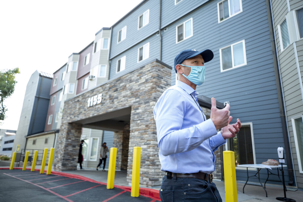 Gunnar Tande, senior vice president with Mercy Housing, stands outside of the Decatur Place Apartments in Sun Valley. Oct. 1, 2020.