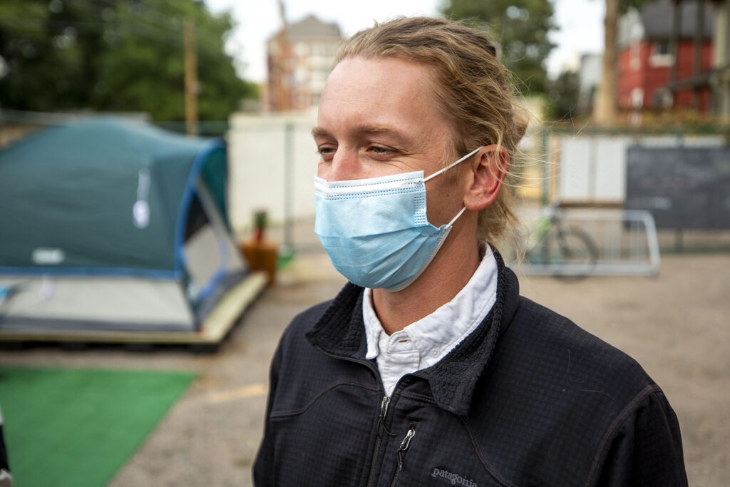 Cole Chandler helped build this mock-up of a sanctioned urban campsite in the parking lot of Belong Church in North Capitol Hill. Oct. 2, 2020.