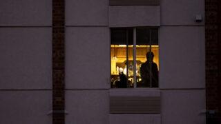 A man stands in a hotel in Centennial. Oct. 6, 2020.