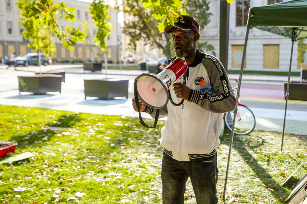 Jerry Burton speaks as Denver Homeless Out Loud begins a multi-day demonstration in front of the City and County Building. Oct. 14, 2020.
