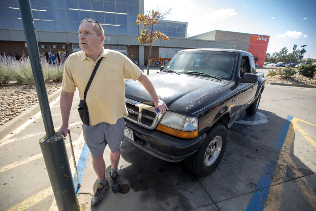 Duane McCormick and his truck, where he's been living recently here outside of a Green Valley Ranch Wal-Mart. Oct. 14, 2020.