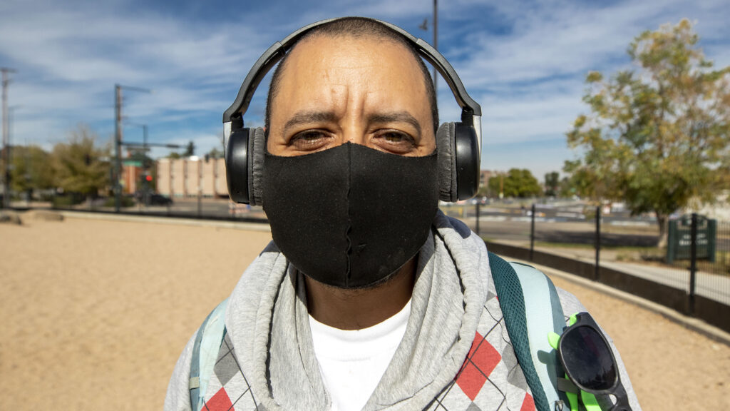 Che Luera was already wearing a mask outside when Denver's tighter rules on face coverings were announced. Oct. 16, 2020.