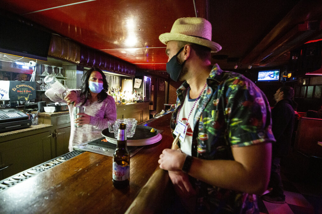 Angela Guerrero, owner of El Chapultepec, listens receptively as Tyler Sondag pitches his Denver Pub Crawl for future, planned, visits to the bar. Oct. 23, 2020.