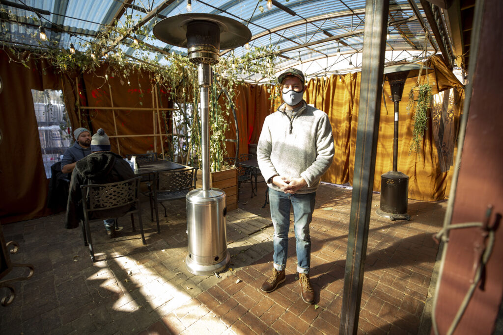 Riley Dorway, general manager of Kaos Pizzeria, at work in his new semi-outdoor patio space in Platt Park. Oct. 27, 2020.