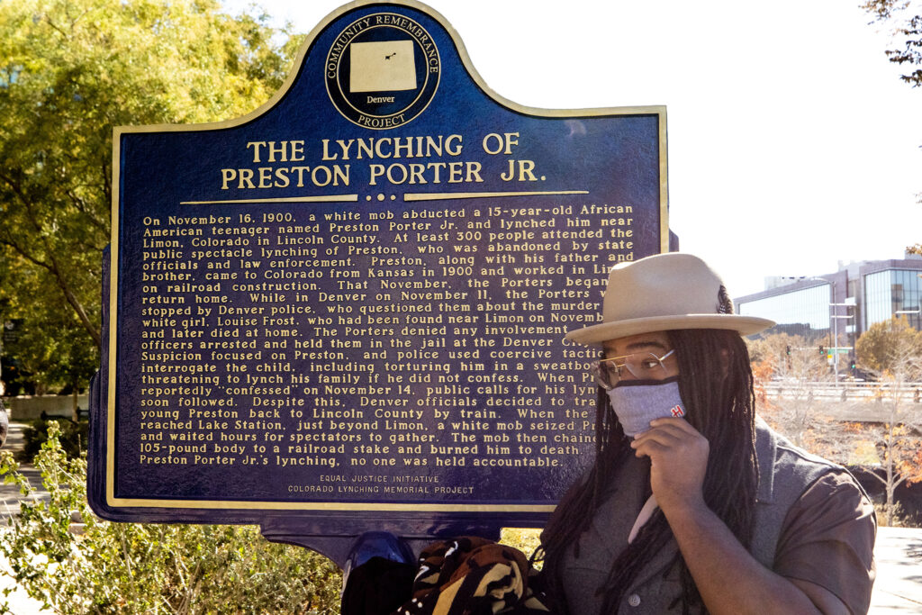 Jovan Mays stands by a new sign downtown that memorializes the lynching of Preston Porter Jr. Oct. 30, 2020.