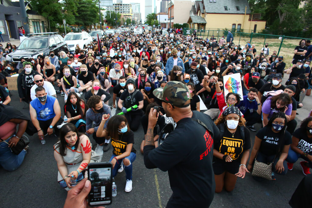 Terrance Roberts leads a march on the Fourth of July through the Five Points neighborhood in Denver, CO, July 4, 2020. On a day when most Americans celebrate independence, this march was focused on ending oppression. Photo by Kevin Mohatt