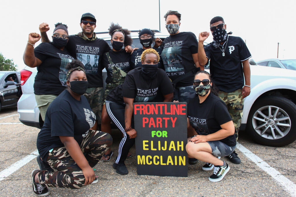 (Left to right, starting in back row) Aariyah Johnson, Terrance Roberts, Lindsay Minter, Sheneen McClain, Candice Bailey, Desmond Lawrence, (front row) Nya Johnson, Shana Shaw and Christabelle Guevara, members of the Frontline Party for Revolutionary Action, which was originally named the Frontline Party for Elijah McClain, and co-founded by Roberts and Bailey in response to the death of Elijah McClain, pose for a portrait at the start of a protest they helped organize in Aurora, CO, July 12, 2020. Photo by Kevin Mohatt