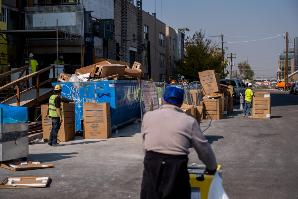 Delgado walks through a construction site in RiNo on Oct. 8, 2020. He often purposefully plans his route along construction sites because the workers, who are often in the sun all day, are frequent customers.