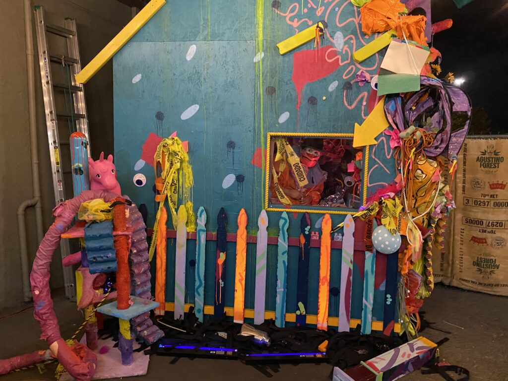 """Sam Gilstrap performs as a clown at a """"No Place to Go"""" installation by artist Moe Gram."""
