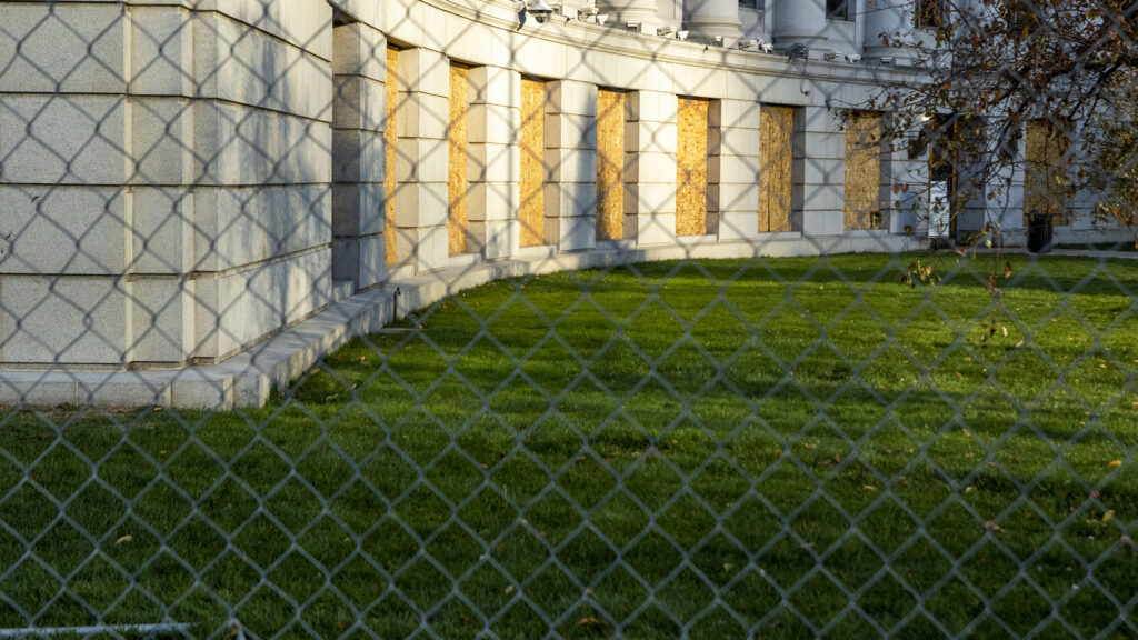 Denver City and County Building is fenced off in preparation for the 2020 election. Oct. 31, 2020.