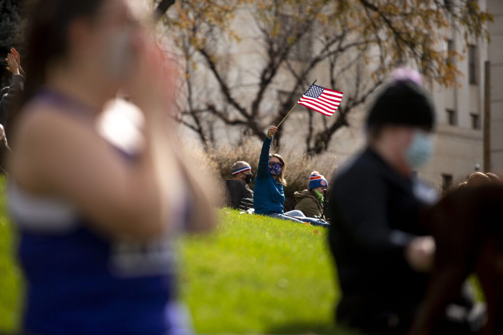 People gathered on the Colorado Capitol lawn celebrate Joe Biden's victory in the U.S. presidential election. Nov. 7, 2020.