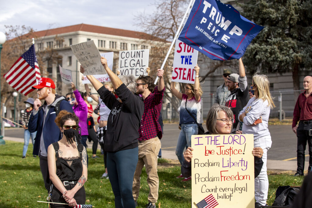 Supporters of President Donald Trump arrived to the Colorado State Capitol as others celebrate Joe Biden's victory in the U.S. presidential election. Nov. 7, 2020.