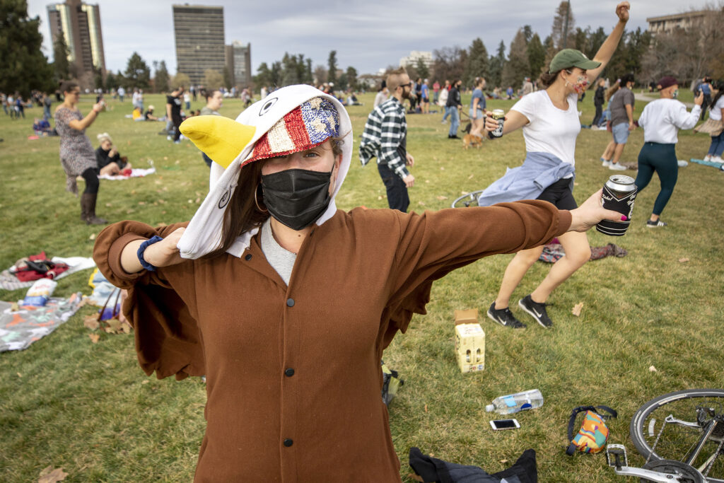 Taylor Soderborg is dressed as a bald eagle as Denverites gathered at Cheesman Park celebrate Joe Biden's victory in the U.S. presidential election. Nov. 7, 2020.