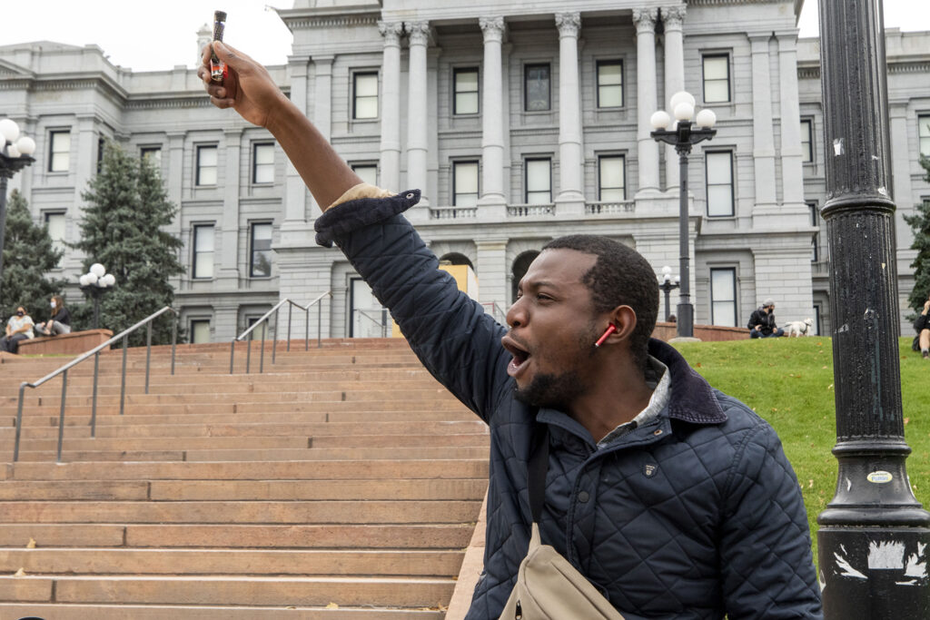 Damarley Laing shouts in front of the Colorado Capitol in celebration of Joe Biden's victory in the U.S. presidential election. Nov. 7, 2020.