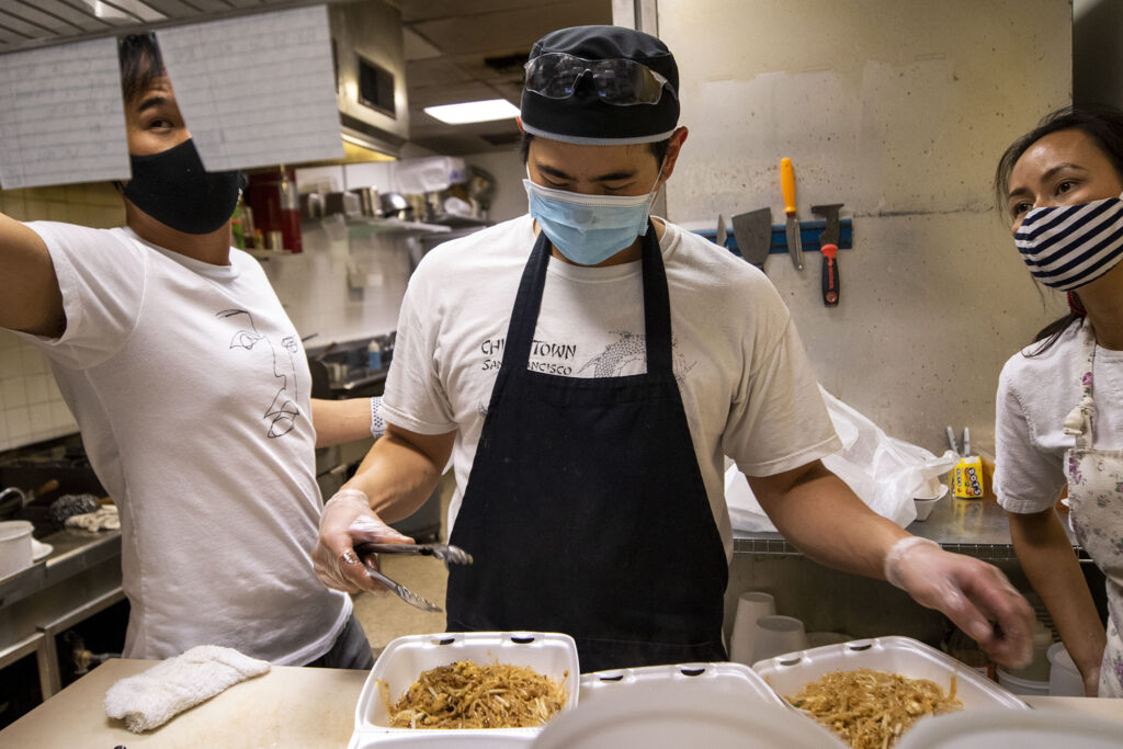 Pacharej (left to right), Prince and Lek Nuntanavooth work the dinner rush in J's Noodle and Star Thai Delivery on Federal Boulevard. Nov. 8, 2020.