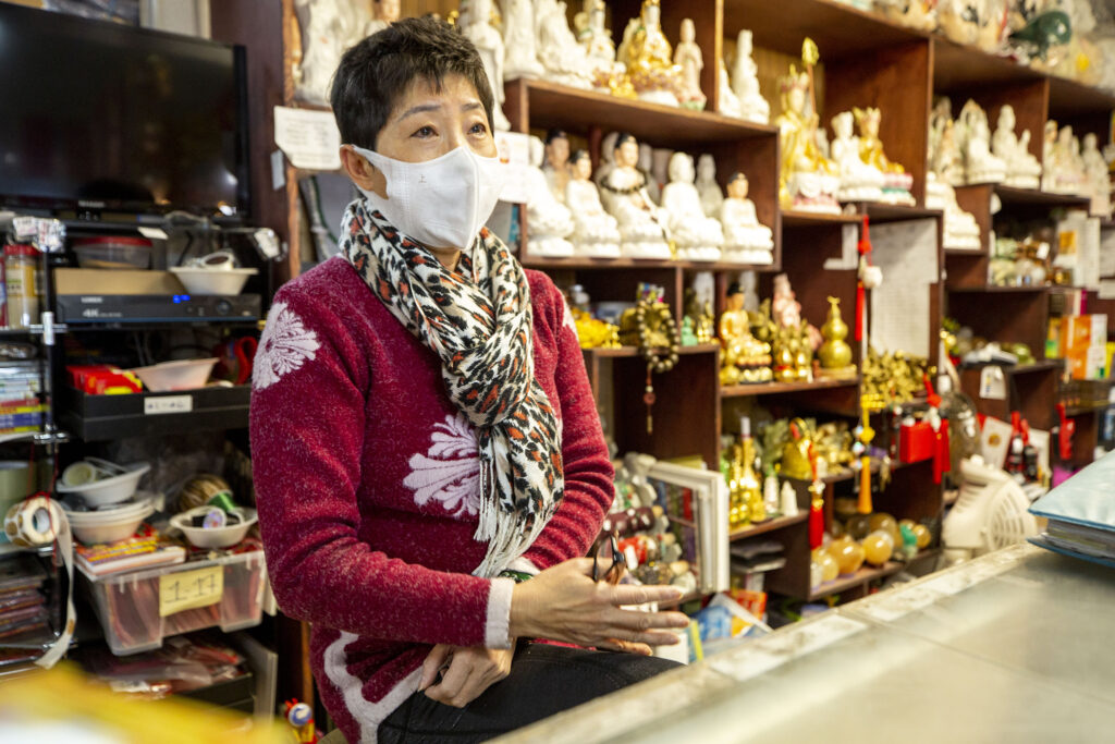 Truong An Gifts owner Fawn Luong behind the counter at her shop on Federal Boulevard. Nov. 10, 2020.