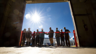Mile High Behavioral Healthcare workers and their supporters cut the ribbon on a warehouse that will become an emergency homelessness shelter in Aurora. Nov. 11, 2020.
