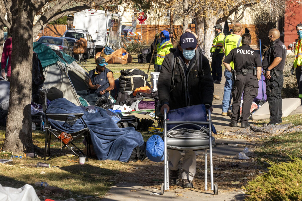 A forced cleanup of an encampment at 19th Avenue and Emerson Street. Nov. 17, 2020.