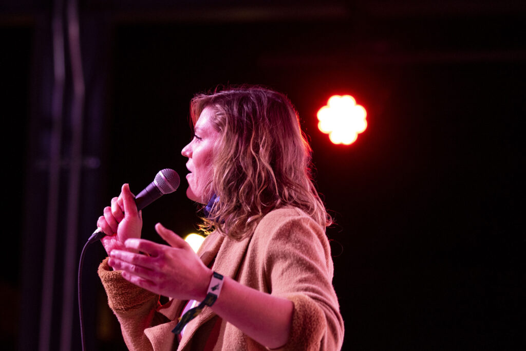 Kate Strobel, comedian and producer of Number Thirty Eight's first-ever monthly comedy night, warms up the crowd. Nov. 28, 2020.