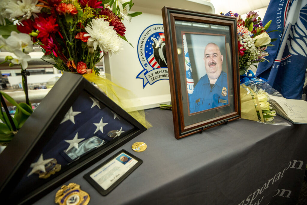 A memorial for TSA agent Eduard Faktorovich, who died after contracting COVID-19, at Denver International Airport. Nov, 21, 2020.