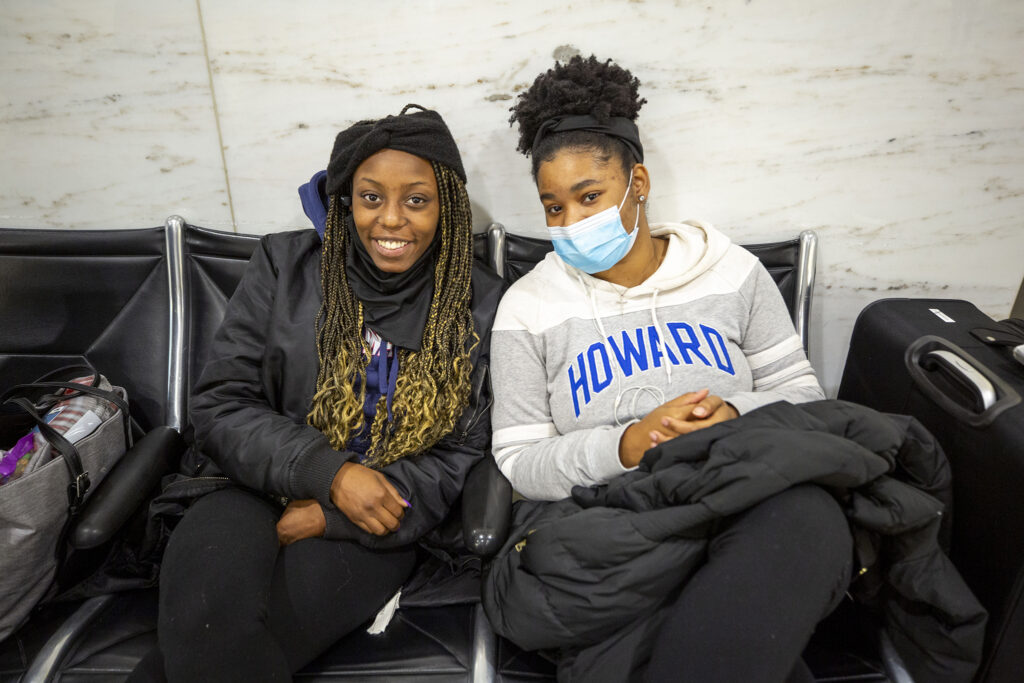 Yolonda Perry and Kalela Woolen wait for bags and friends at Denver International Airport. Nov, 21, 2020.