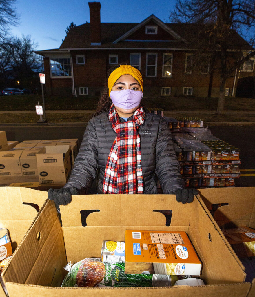 Ruby Blaine packs boxes during the annual Denver Feed a Family event on Bruce Randolph Avenue in Cole. Nov. 21, 2020.