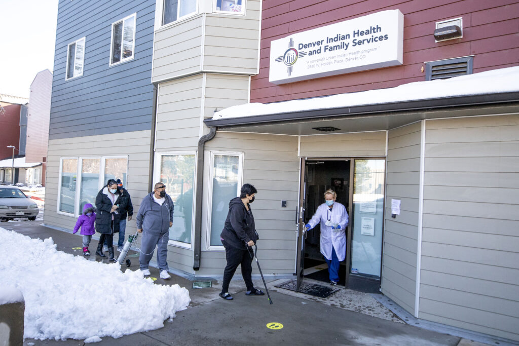 The Wilson family enters the Denver Indian Health and Family Services clinic in Sun Valley. Nov. 24, 2020.