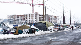 A large encampment of people living without permanent housing on Arkins Court in Five Points, around the corner from the Crossroads shelter. Nov, 24, 2020.
