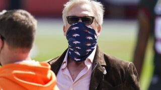 John Elway, president of football operations for the Denver Broncos, looks on before an NFL football game against the Tampa Bay Buccaneers, Sunday, Sept. 27, 2020, in Denver. (AP Photo/Jack Dempsey)