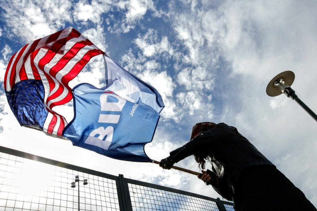 Walter Avko waves a Joe Biden flag on Election Day, November 3, 2020.